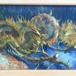 Vier uitgebloeide zonnebloemen door Vincent van Gogh