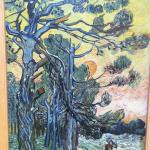 Dennenbomen bij zonsondergang door Vincent van Gogh